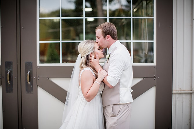Groom kissing bride | Stylish and Modern Farm Wedding | Amanda May Photos