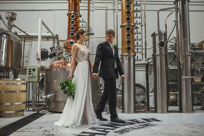 Bride and Groom in distillery | Distilled Love | Kirsten Stanley Productions
