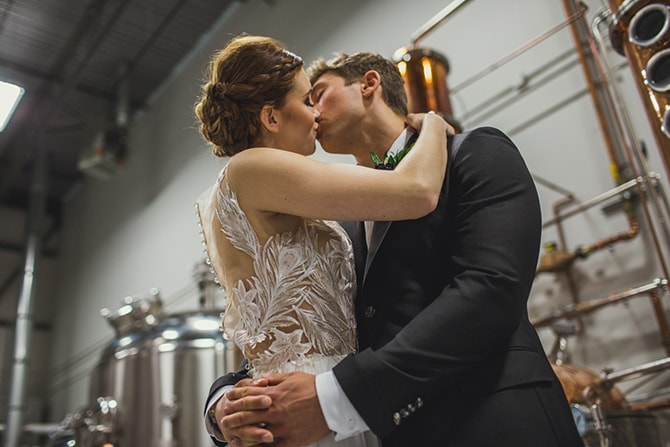 Couple kissing in distillery | Distilled Love | Kirsten Stanley Productions