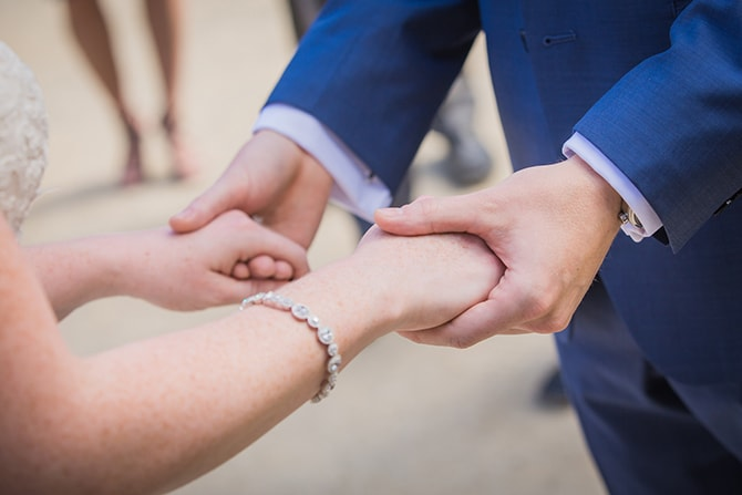 Couple holding hands | Travel Themed Intimate Wedding in Paris - Paris Photographer Pierre