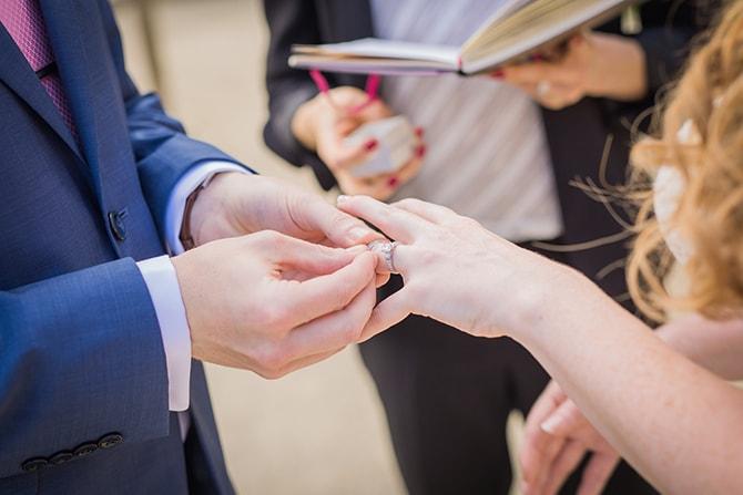 Groom putting wedding ring on bride | Travel Themed Intimate Wedding in Paris - Paris Photographer Pierre