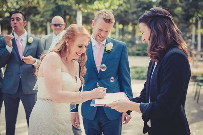 Signing the registry | Travel Themed Intimate Wedding in Paris - Paris Photographer Pierre
