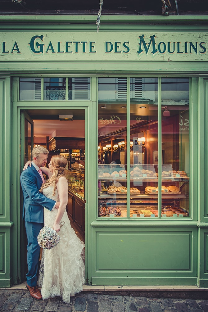 Couple kissing in French Café | Travel Themed Intimate Wedding in Paris - Paris Photographer Pierre