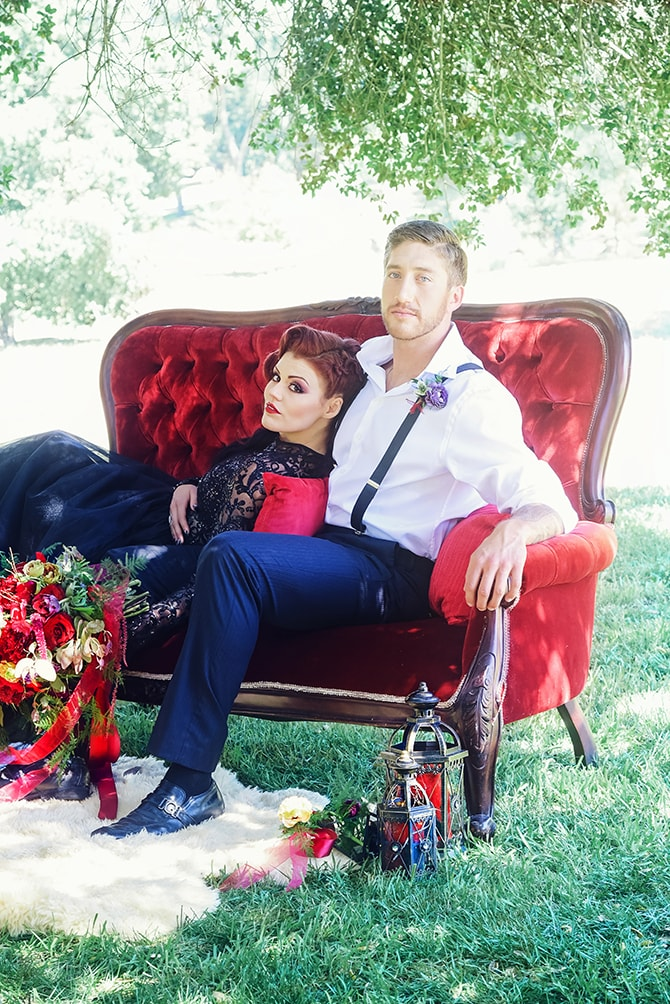 Bride and groom on red sofa | Dark Romance at Milagro Winery | Lacey O Photography