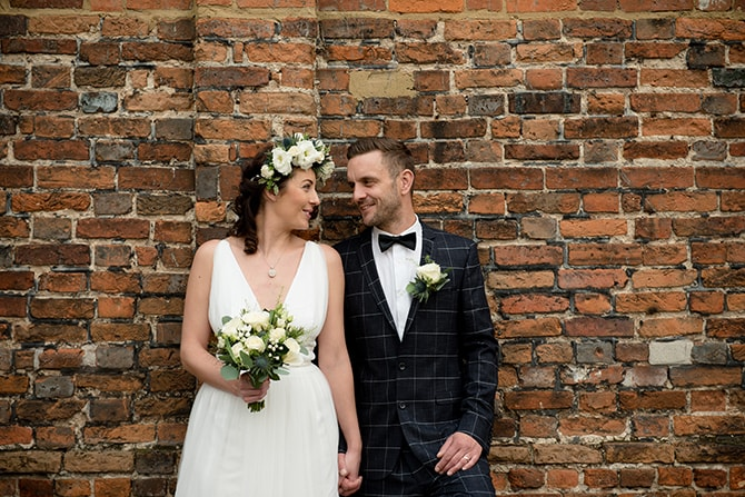 Bride and Groom infront of brick wall | Beautiful Countryside Wedding Inspiration in Buckinghamshire | KLP Photography