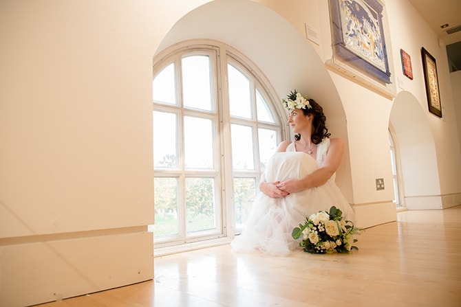 Bride sitting beside window | Beautiful Countryside Wedding Inspiration in Buckinghamshire | KLP Photography