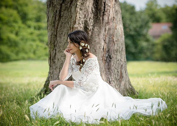 Bride sitting on grass | Contemporary Summer Bridal Inspiration