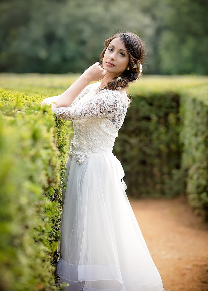 Bride in garden maze | Contemporary Summer Bridal Inspiration