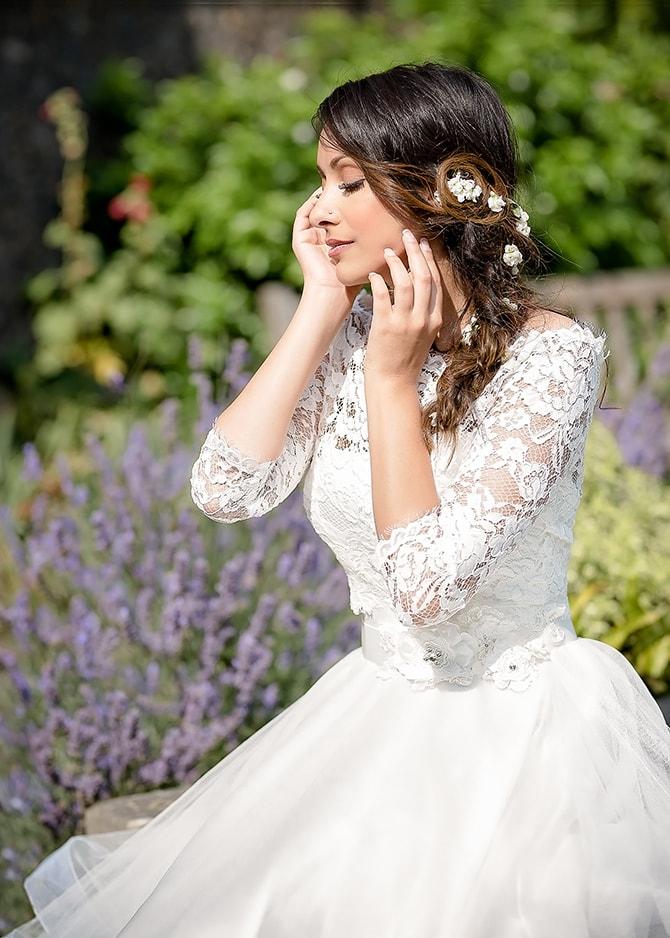 Bride in garden beside lavender | Contemporary Summer Bridal Inspiration