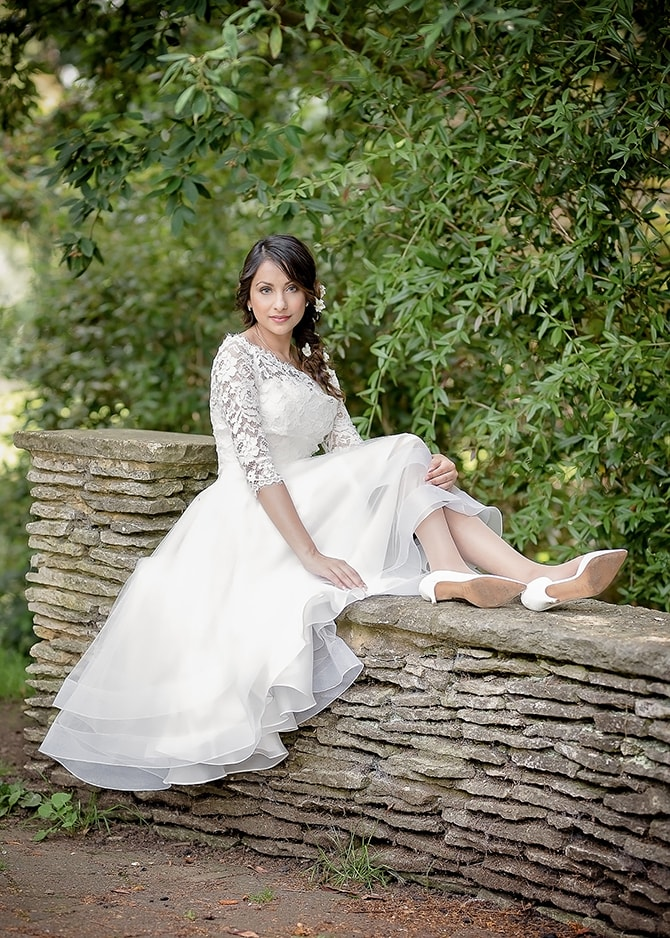 Bride sitting on wall | Contemporary Summer Bridal Inspiration