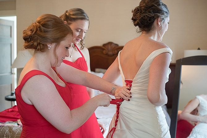 Bride getting dressed for wedding | Modern Elegance in Exeter - Emily Teresa Photography
