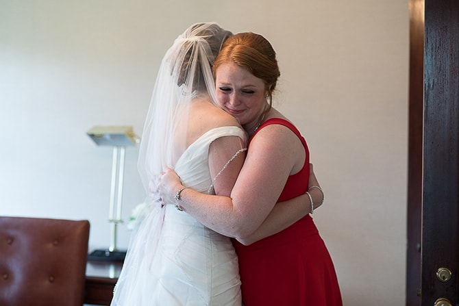 Bride hugging bridesmaid | Modern Elegance in Exeter - Emily Teresa Photography