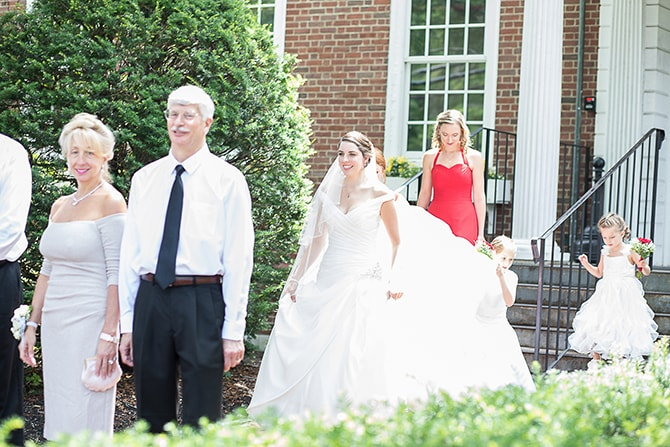 Bride walking up to parents | Modern Elegance in Exeter - Emily Teresa Photography