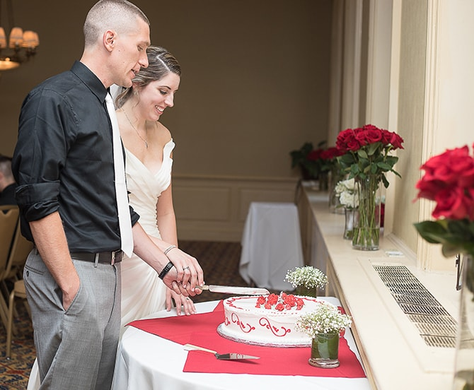 Couple cutting wedding cake | Modern Elegance in Exeter - Emily Teresa Photography