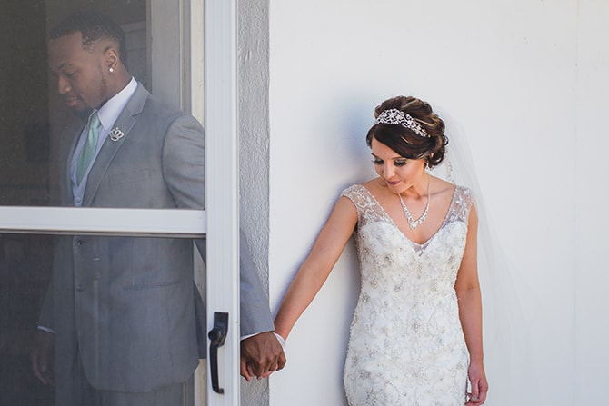 Bride and Groom holding hands through door before ceremony | Stylish Traditional Wedding in Kansas | Wisdom-Watson Weddings
