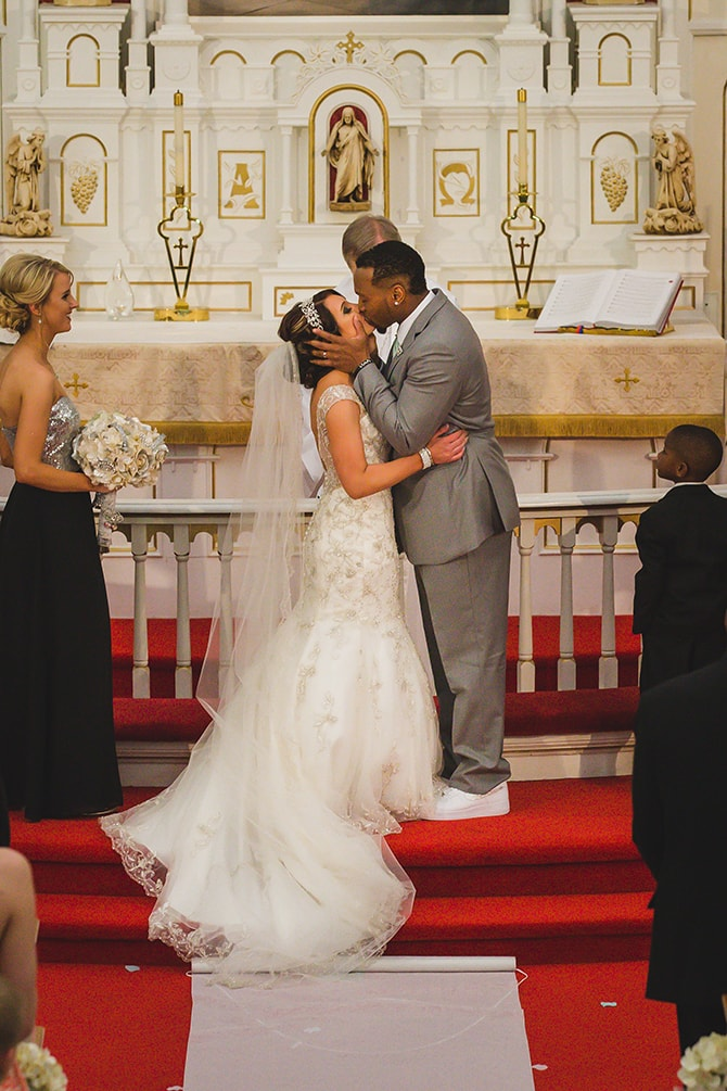 Bride and Groom kissing in church | Stylish Traditional Wedding in Kansas | Wisdom-Watson Weddings