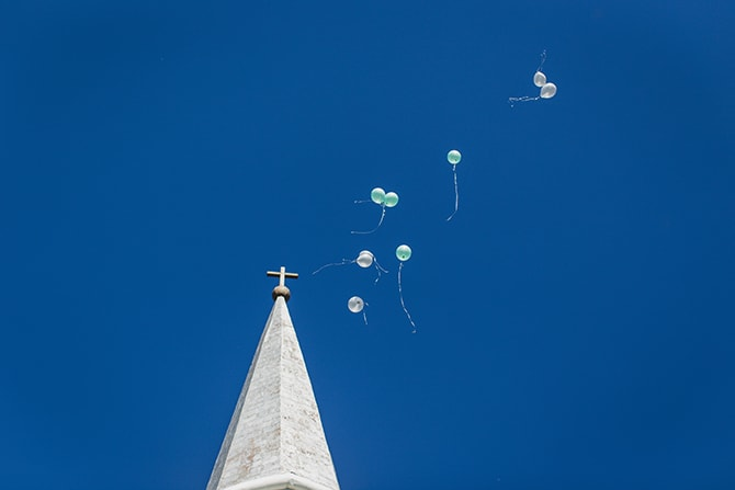 Balloons and church | Stylish Traditional Wedding in Kansas | Wisdom-Watson Weddings