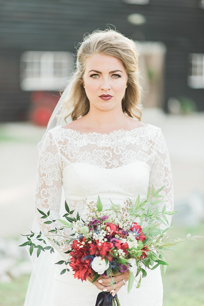 Bride with red bouquet and lips | A Very Boho Christmas | Kayla Duffey Photography