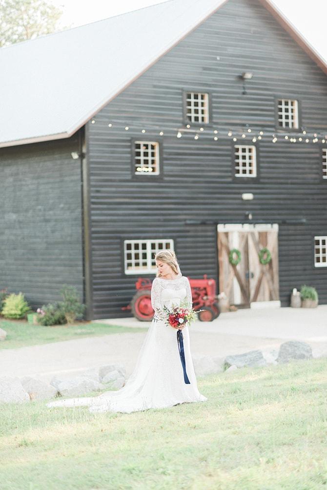 Winter bride outside cabin | A Very Boho Christmas | Kayla Duffey Photography