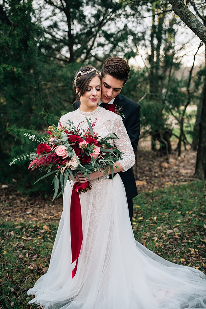 Bride and groom with festive bouquet | Intimate Winter Chapel Wedding | Rebecca Chesney Photo