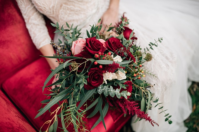 Red and green bridal bouquet | Intimate Winter Chapel Wedding | Rebecca Chesney Photo