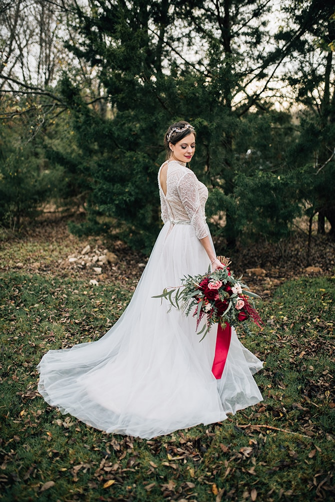 Bride with festive bouquet | Intimate Winter Chapel Wedding | Rebecca Chesney Photo