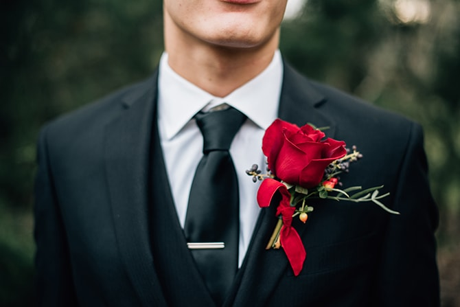 Groom with red rose buttonhole | Intimate Winter Chapel Wedding | Rebecca Chesney Photo