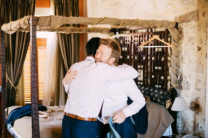 Groom huggin best man | Natural Alfresco Wedding in Crete HannaMonika Photography