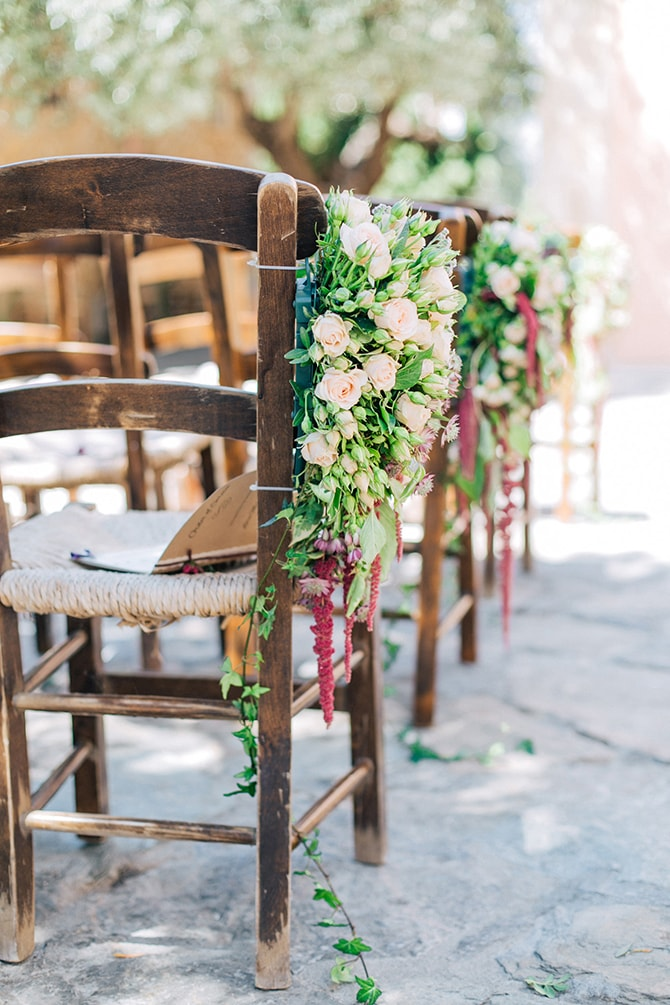 Wedding aisle chair flowers | Natural Alfresco Wedding in Crete HannaMonika Photography
