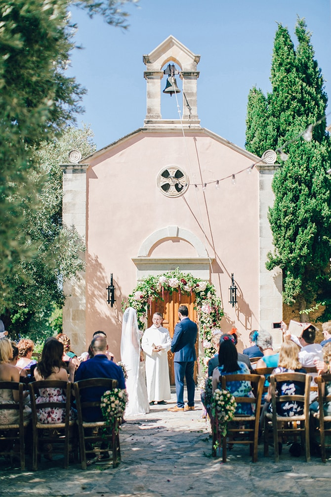 Bride and Groom at Altar | Natural Alfresco Wedding in Crete HannaMonika Photography