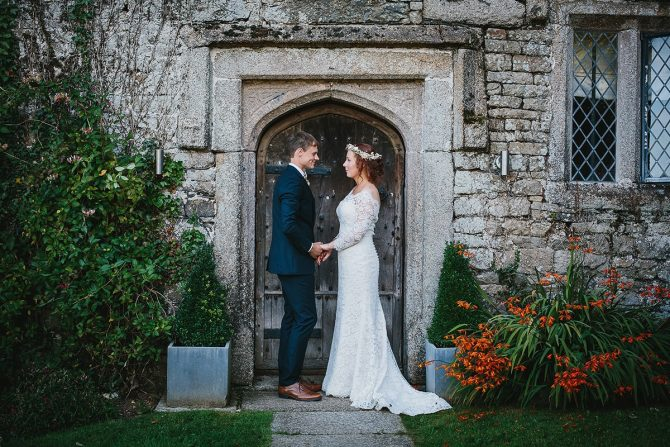 Couple standing outside Pengenna Manor in North Cornwall
