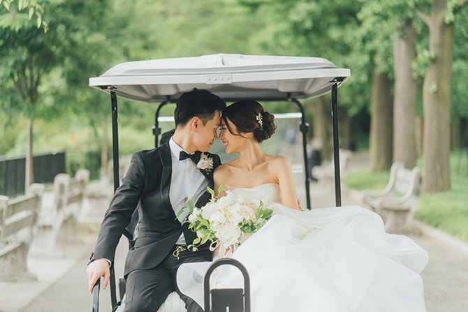 Groom and Bride on golf cart