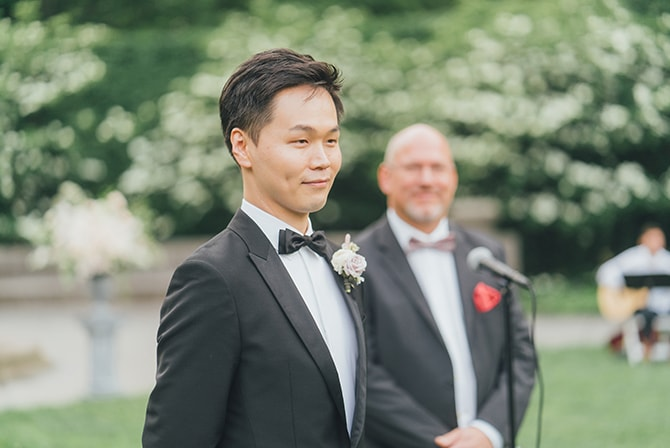 Groom watching his bride arrive