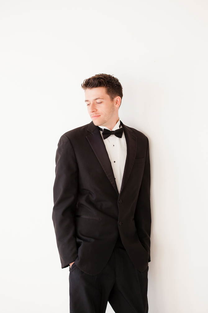 Stylish groom in black tux