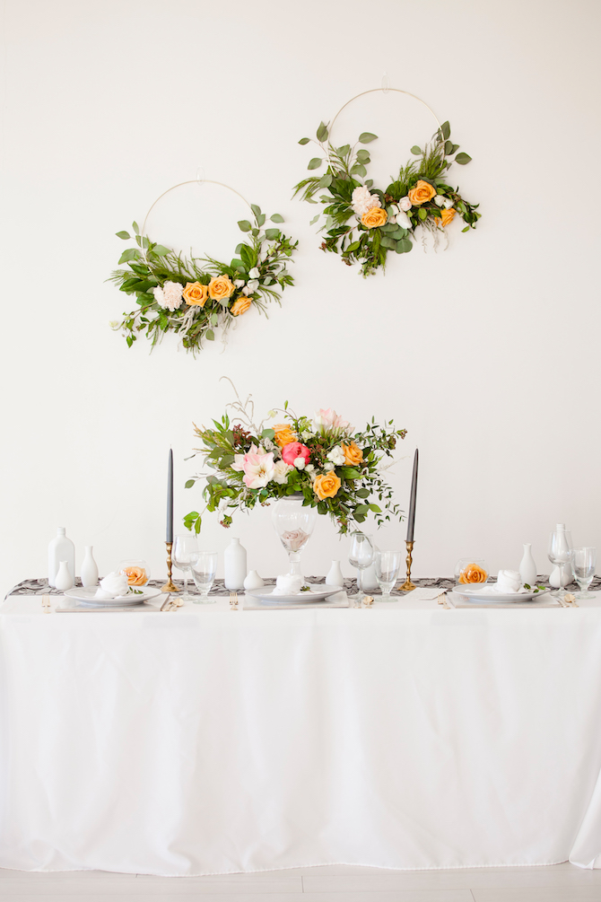 Simplistic wedding reception with flower wreaths