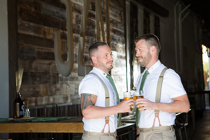 Couple enjoying a beer before wedding