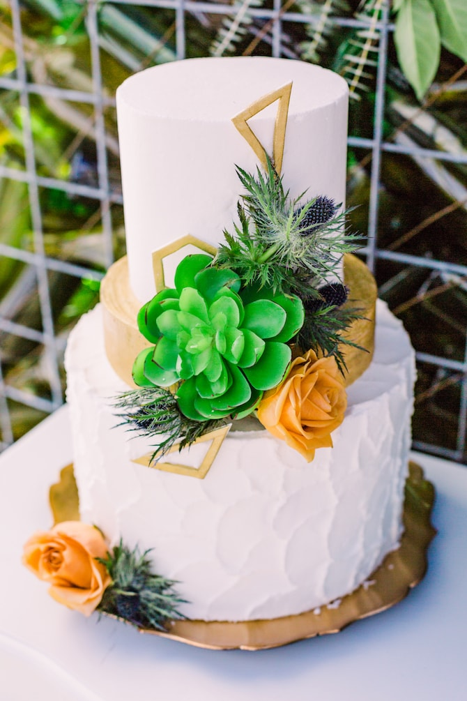 Modern geometric white wedding cake with succulents