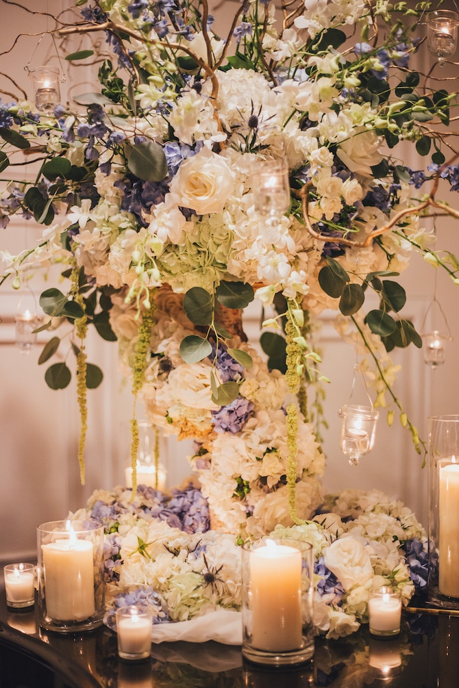 Floral wedding centrepiece | Fabulous Floral Wedding at The Park Savoy Estate