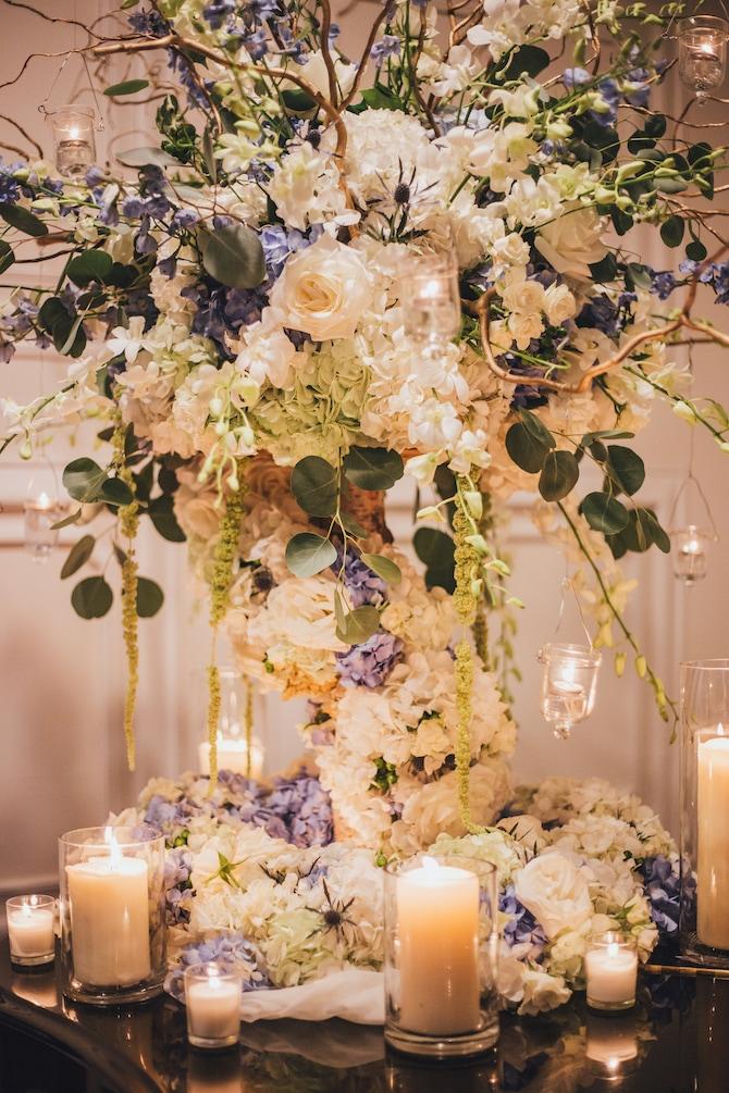 Floral wedding centrepiece | Fabulous Floral Wedding at The Park Savoy Estate