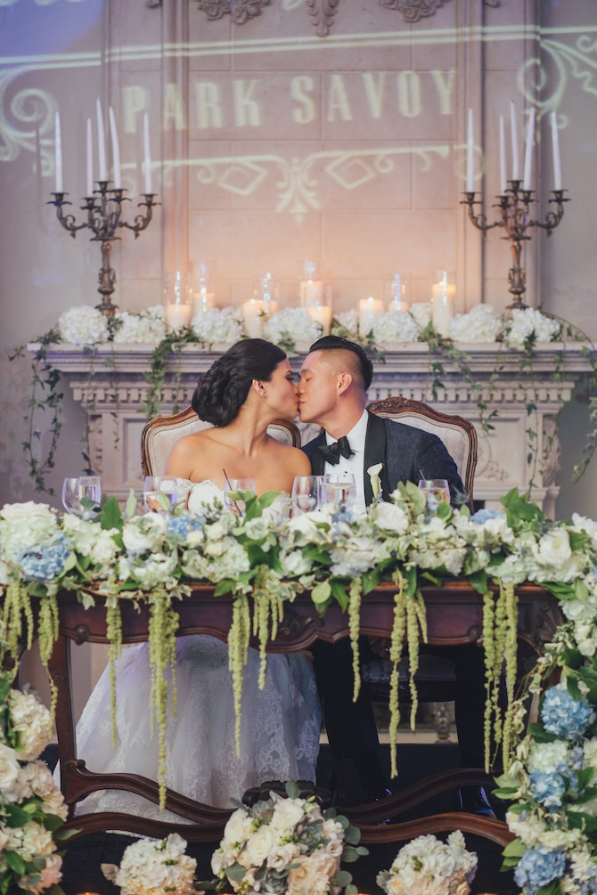 Couple on top table | Fabulous Floral Wedding at The Park Savoy Estate