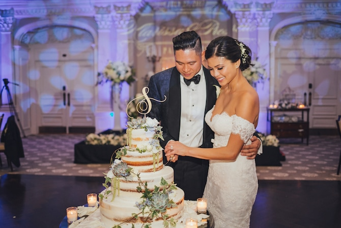 Cutting the cake | Fabulous Floral Wedding at The Park Savoy Estate