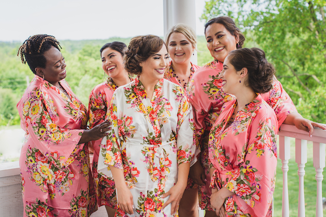 Bride and bridesmaids in floral robes | Glamorous Multicultural Wedding in Kansas City