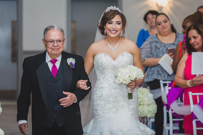 Bride walking down aisle | Glamorous Multicultural Wedding in Kansas City