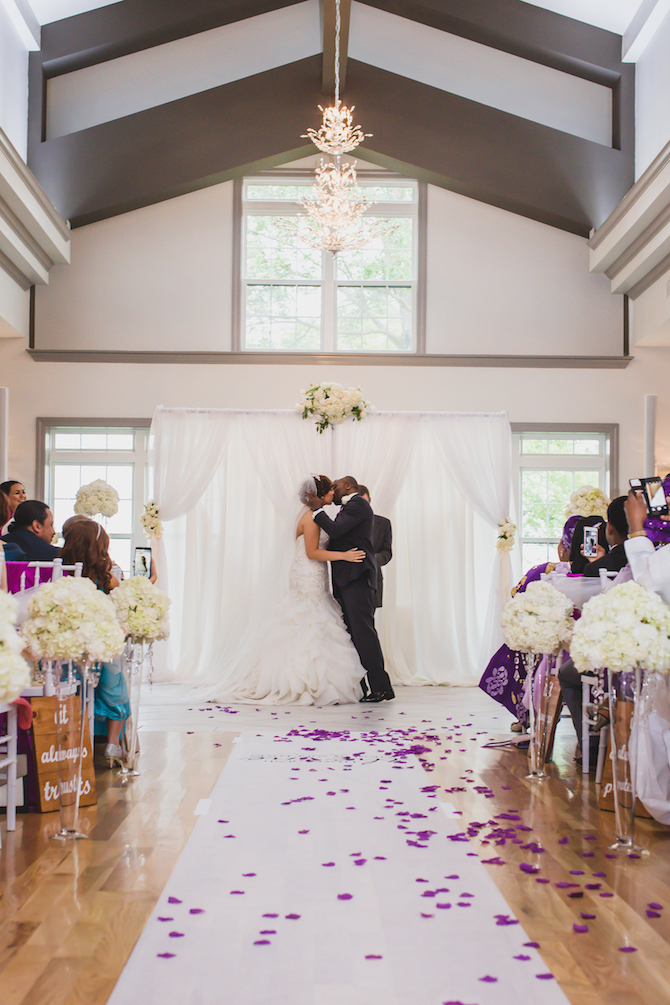 Kissing at ceremony | Glamorous Multicultural Wedding in Kansas City