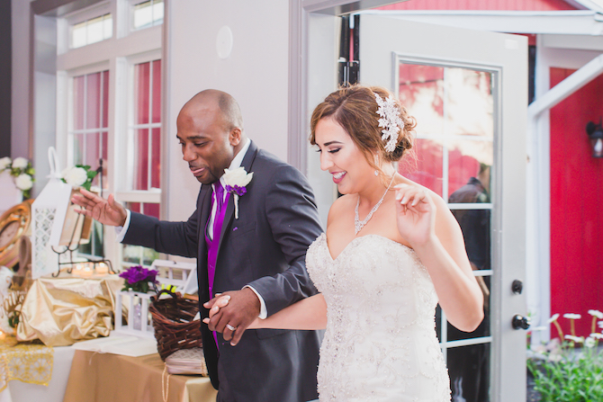 Newlyweds arriving at reception | Glamorous Multicultural Wedding in Kansas City