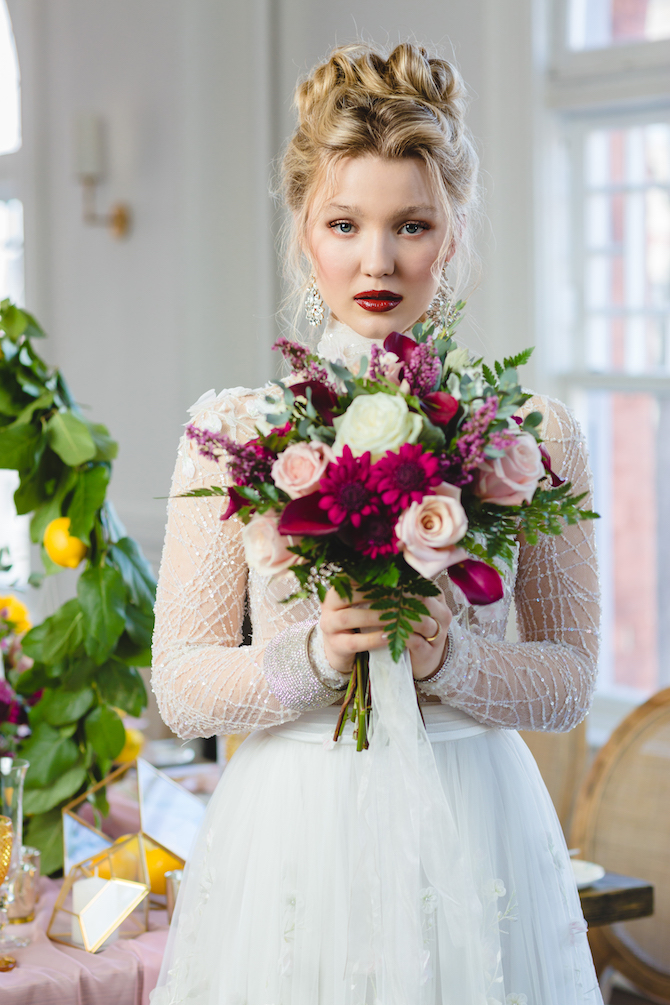 Bride with dark lipstick and red and pink flowers