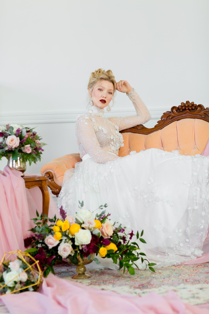 Bride sitting on chaise lounge