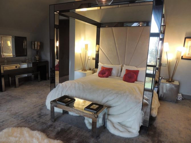 Master Bedroom with Mirrored Four-Poster Bed at Lakes by Yoo The Barnhouse