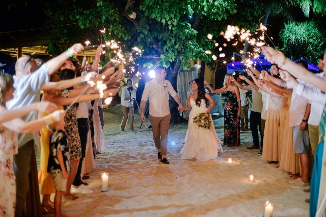 Bride and Groom walking through aisle of sparklers