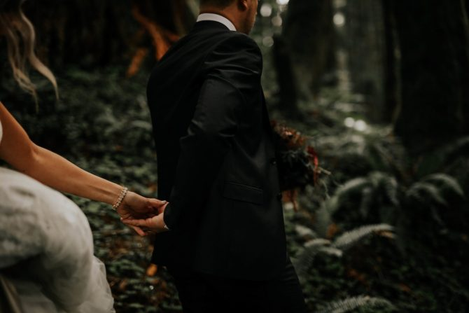 Couple walking through woods | Real Wedding Janay and Jono